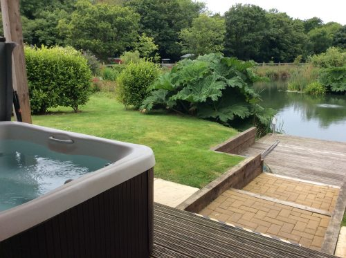 Mallard Hot Tub - Fishing Holidays in England at Mallard Lodge, Nanpusker Lakeside Lodges, Cornwall. This luxurious lodge overlooks a private fishing lake exclusively for guests staying at this lodge.