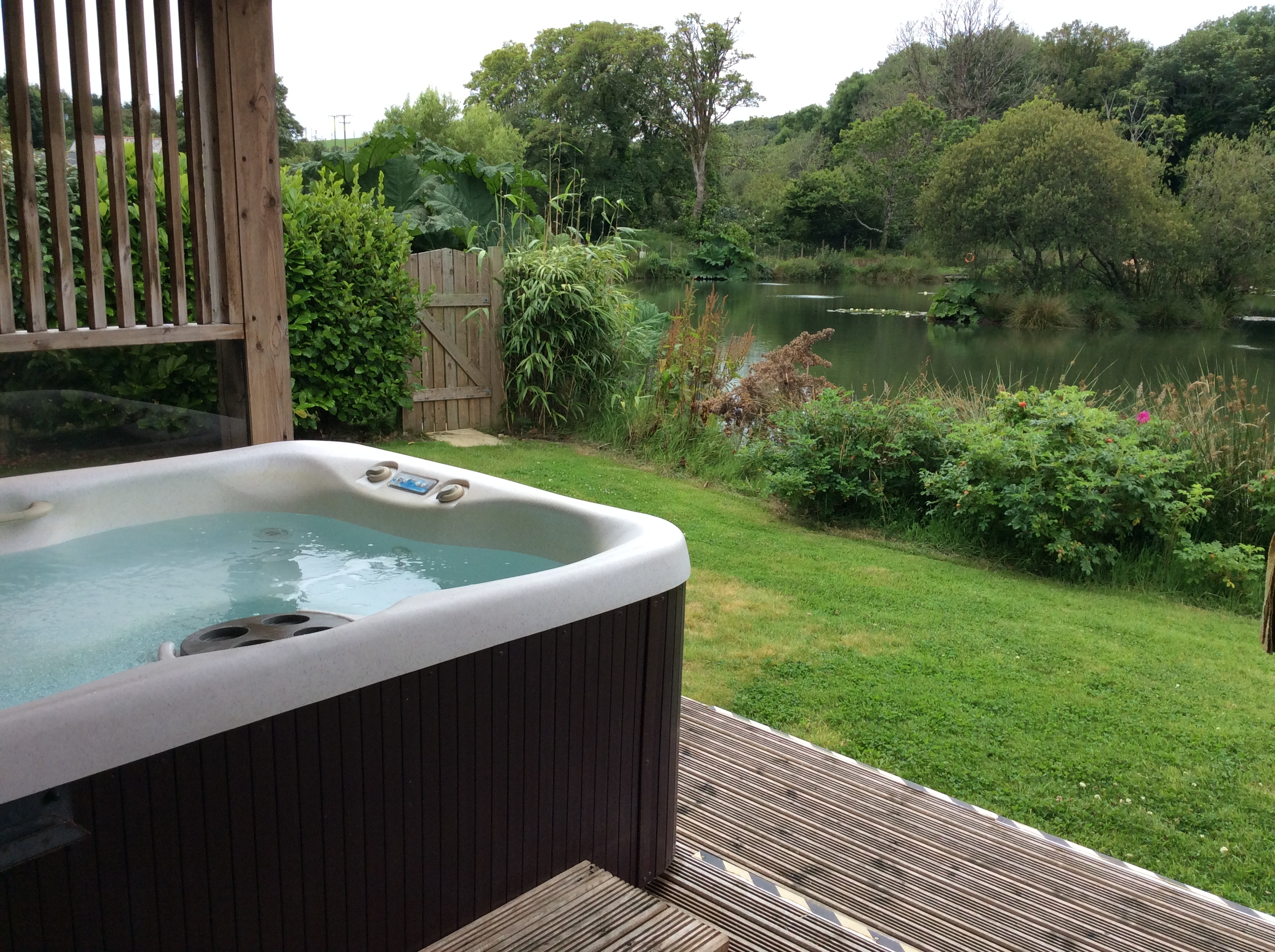 Hot tub and fishing holidays at Woodpecker Lodge. Luxurious accommodation, a private fishing lake and a hot tub for those nights under the stars. Just another day at Nanpusker Lakeside Lodges, Cornwall.